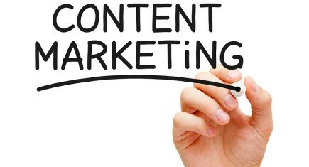 handing writing on whiteboard saying content marketing strategy
